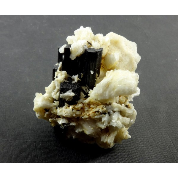 Black Tourmaline Crystal surrounded by Cleavelandite with Apatite